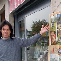 Erba, negozi e pubblicità   al braccio di ferro