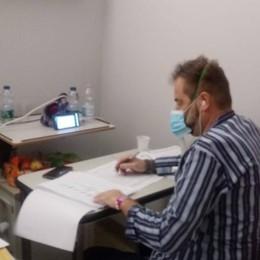Capiago, sindaco in consiglio  collegato dall'ospedale