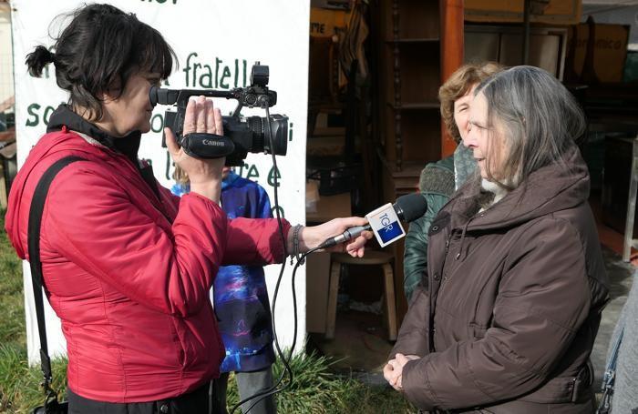 Elsa Pandiani,collaboratrice di don Emilio e dell'attuale parroco, risponde alle domande del Tg3 regionale
