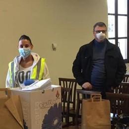 Olgiate Comasco  negozio regala  5mila mascherine