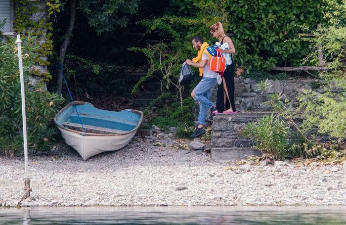 Como in motoscafo con la Guardia di Finanza per controlli sul lago gite fuori porta nel giorno di Pasquetta, coronavirus, gitanti in fuga da una spiaggia a Lenno