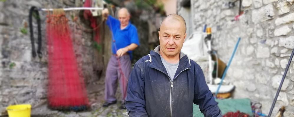 «Noi, una vita da pescatori  Insieme al lago che cambia»